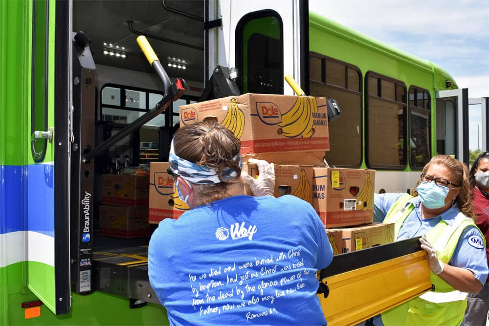 Image of woman loading bananas on the bus